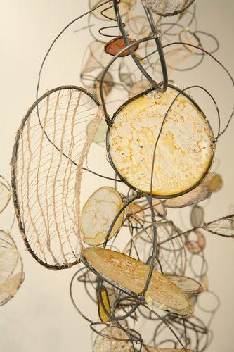 "Rickie Wolfe - detail of instalation, metal, wire, paper, fibers, wax 90""H x 99""W"
