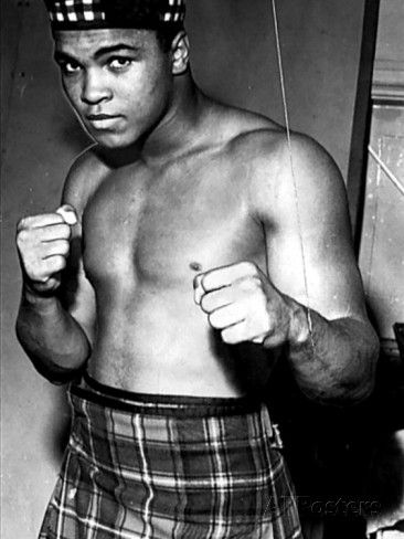Boxer Muhammad Ali Dressed in Tartan Kilt Glengarry Hat Clenched Fists  Item #: 4157271