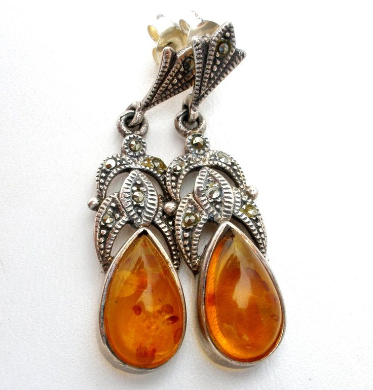 """Pierced Dangle Earrings - This is a pair of vintage sterling silver drop earrings with amber stones and marcasites. They are 1.25"""" long, .38"""" wide, hallmarked 925, and weigh 4.9 grams. Beautiful earri"""