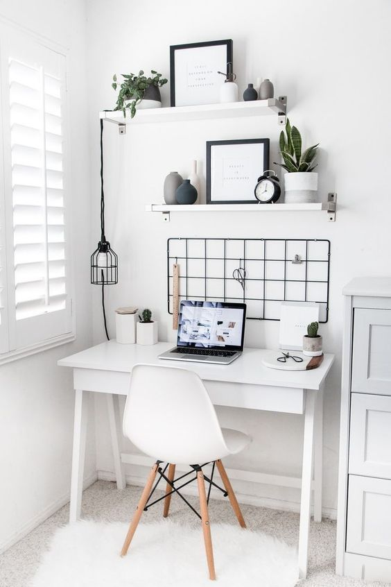 white home office with black accents and plants