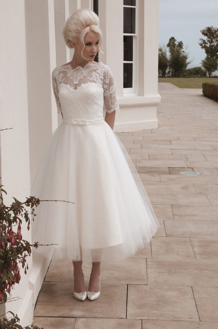 wedding dresses short fitted wedding dresses Mooshki Darla Tulle and lace vintage inspired calf length gown with elbow length fitted sleeves Tea Length Wedding DressShort