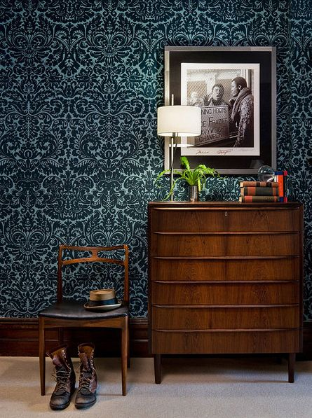 This large scale, dark background wallpaper print is perfect for medium to larger spaces where you wish to create more intimacy such as a bedroom or dining room. The large scale of the print balances out the size of the space, while the dark background draws your eye inward and creates a cozy feeling. Medium to large scale traditional furniture pieces in dark wood tones and either a light-colored carpeting, or dark wood floor with a light rug will finish the overall effect nicely!