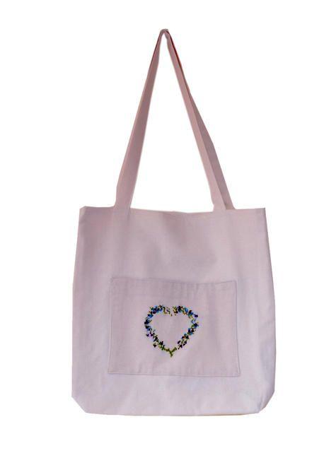 Praktická taška s ruční výšivkou.