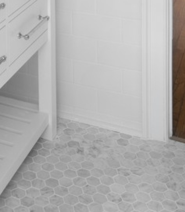 Hex tiles for floor and subway white for shower wall