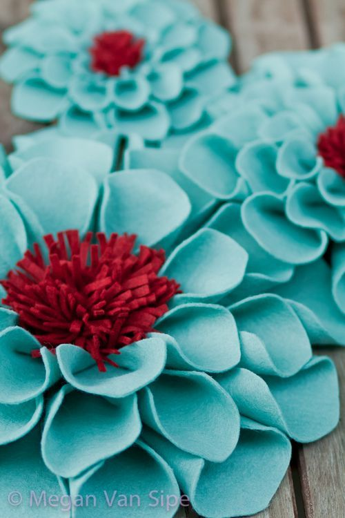 big felt flowers - time to bust out the hot glue gun to make this myself.  I would love to put on a pillow....I also want to paint the girls' shoe rack the blue color w/ that red of a curtain to pull in front! Love it!