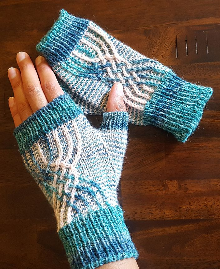 Free Knitting Pattern for Non-Hyphenated Mitts - These fingerless mitts feature a colorful woven line design of twisted stitches and slipped stitch colorwork. Designed by Leah Blackwood. Pictured project by andrealea
