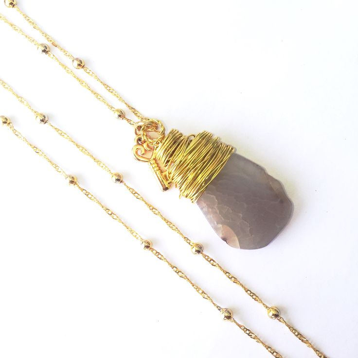 A personal favorite from my Etsy shop https://www.etsy.com/listing/533304713/gold-filled-long-chain-necklace-with