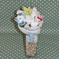 Baby bouquet filled with gorgeous baby products - a unique way of presenting baby shower gifts