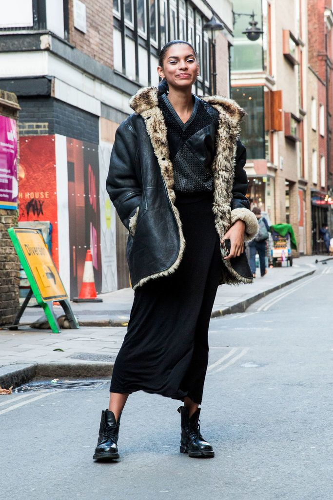 An oversized jacket layered over a midi dress and combat boots.