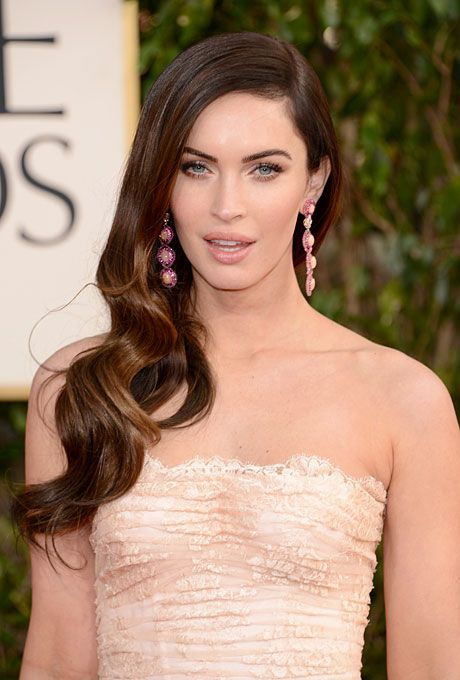 Brides.com: . Megan Fox's Wavy Side-Swept Twist. Another trend on last night's red carpet (besides bouncy retro waves)? Side-swept strands with a major side part (which, of course, Megan Fox totally rocked).    Browse more long wedding hairstyles.