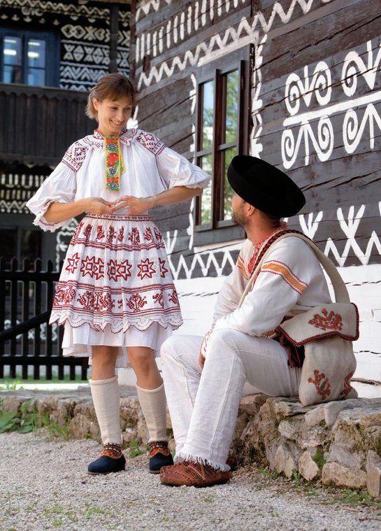Europe | Portrait of a couple wearing traditional clothes, Čičmany village, Považie region, Western Slovakia