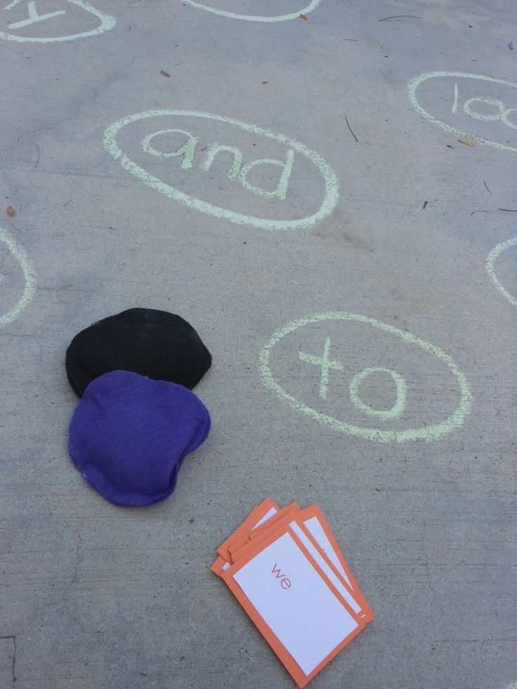 Another chalk game!  Write the sight words on the driveway.  Toss a bean bag (or small stuffed animal) onto the word.  Read the word!  Amy