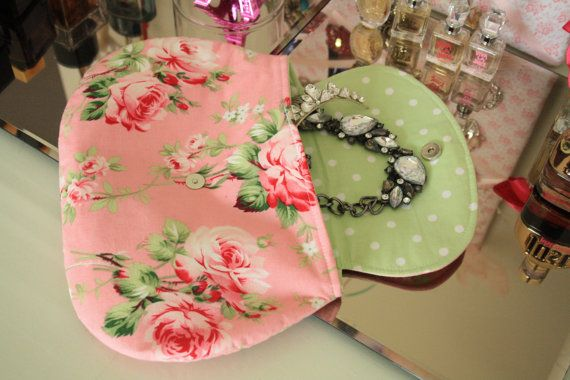 This fabric clutch has been handcrafted to a fine quality. Made with pastel pink rose fabric on the outside and pastel green polka dot in the inside