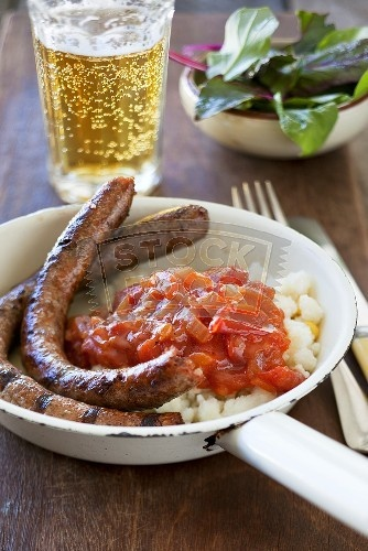 Boerewors, Pap and a cold beer. South African delicious sausage generally cooked on the braai (BBQ) served with pap, which is made from mealie meal (corn meal) and served with a tomato and onion gravy -- finished off with a delicious cold beer