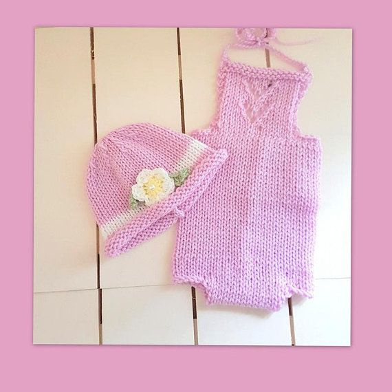 Sweet Pink Baby Romper with lace detail on the bib, with a matching roll-brim beanie with a crochet flower.  Newborn size, this would make a lovely baby shower gift. The little hat has a roll brim, so that it can be rolled up or down, as baby grows. The crochet flower has a little