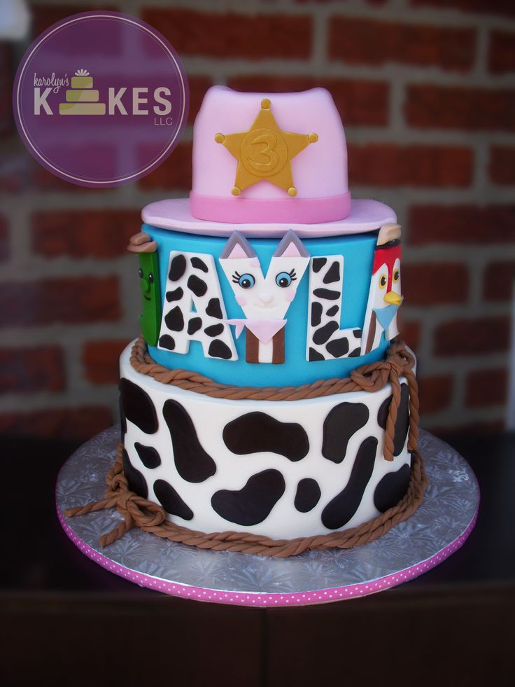 Sheriff Callie Wild West cake Hat is cake covered in Marshmallow Fondant (MMF) All letters of her name (Toby, Callie, Deputy Peck) are also MMF.  Bottom 2 cakes are iced in buttercream.  MMF cow print.