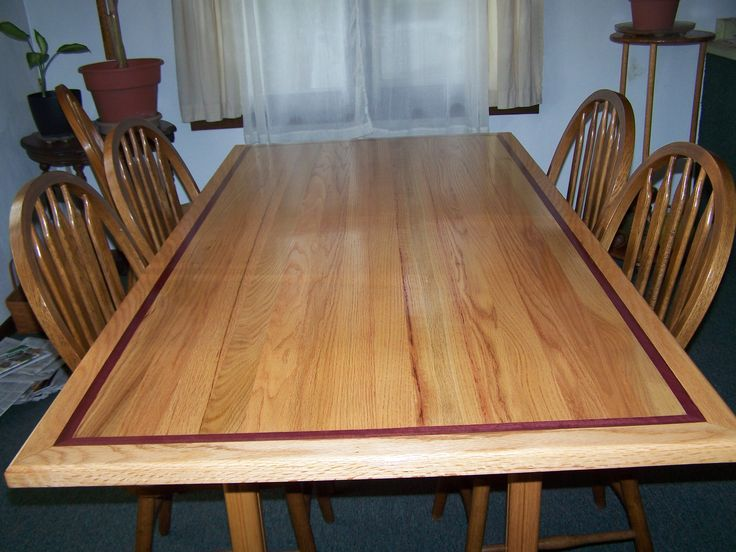 Dinningroom table with purple heart wood inlay  Not purple though, a