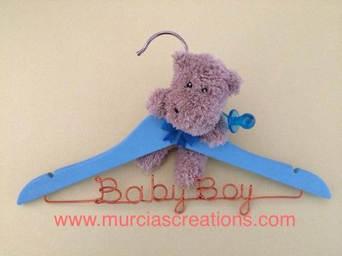 """""""Baby Boy"""" Coat Hanger. Isn't it cute? Lovely handmade blue hanger with wording in copper wire and a fluffy baby hippo. The perfect gift idea for baby showers and newborns. $25. Aud."""