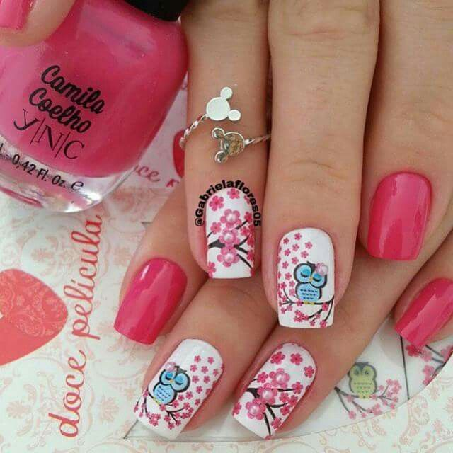 Cherry blossom and owl nails.