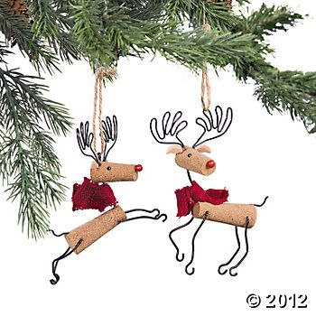 """Reindeer Ornaments  Crafty and cute, these precious little reindeer will dance and prance in the boughs of your tree. Made from cork, these Christmas tree ornaments would make a fun gift for the wine lover on your gift list. Cork. Set of two. 5""""L x 5""""W. $ 7"""