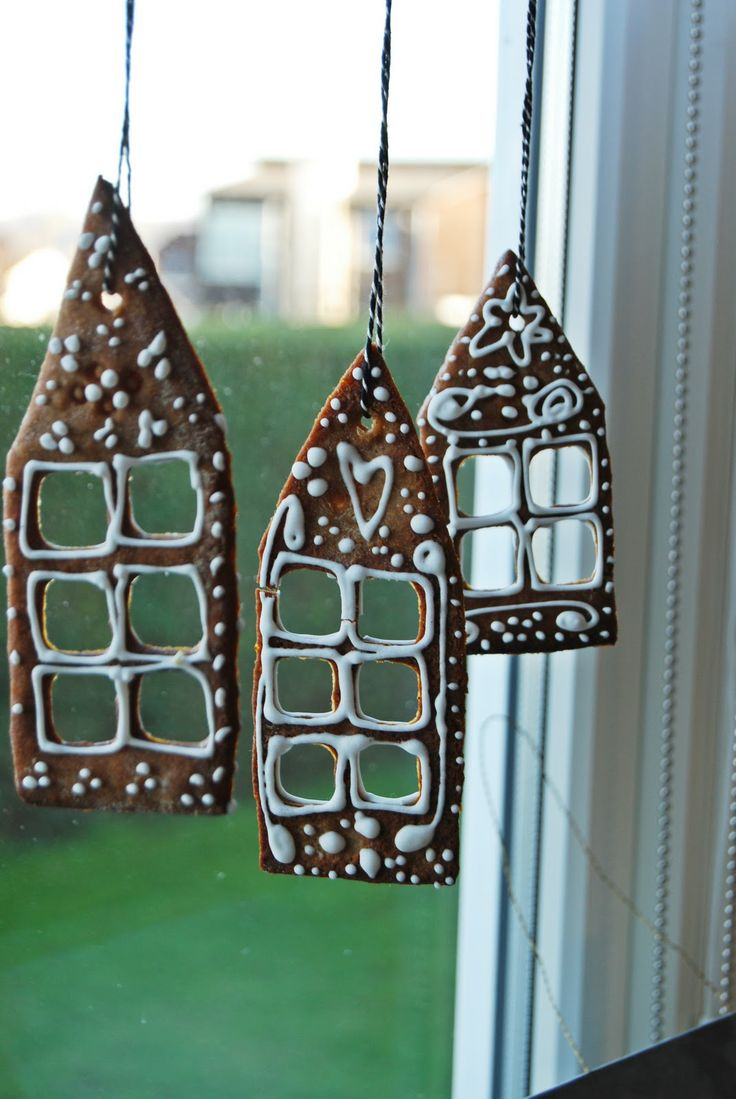 Gingerbread house shapes hanging in the window.