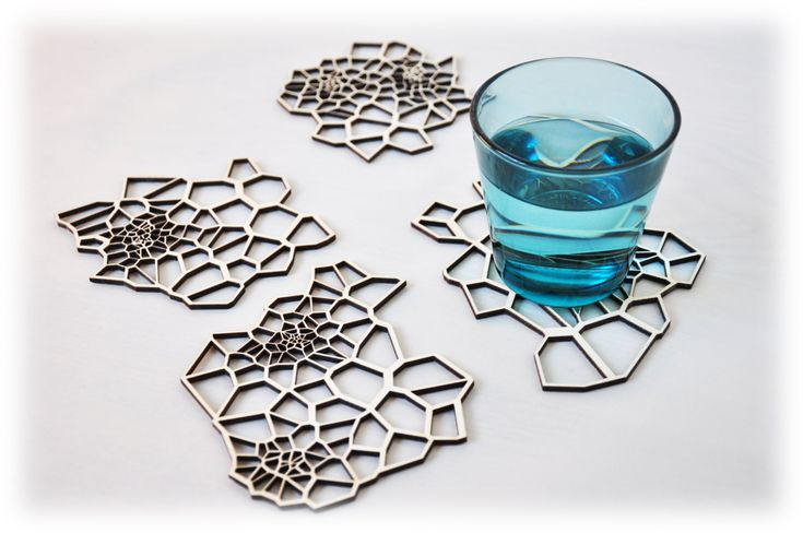 Geometric wooden drink coasters - laser cut pattern - set 4. $25.00, via Etsy.