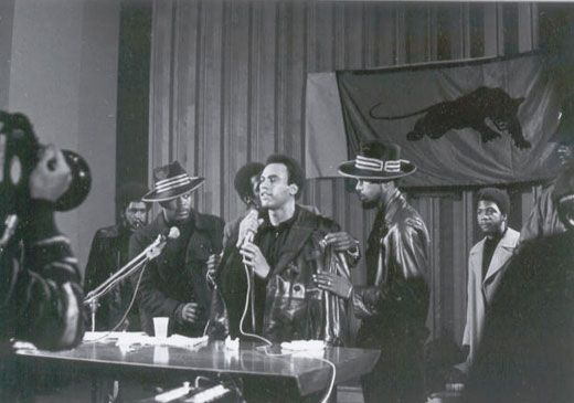 Huey P. Newton speaking at Merritt College, Oakland, California, undated/uncredited. (am thinking this is the old Merritt--later, briefly North Peralta Com. College-- when it was on the then-Grove Street campus, now used by Children's; does anyone know? rw)