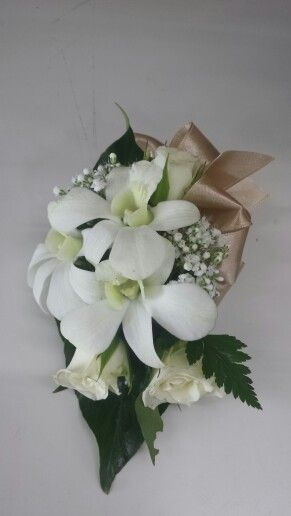 White Singapore orchid and spray rose corsage