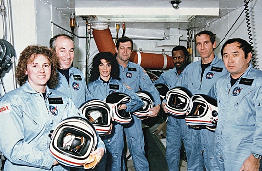 The Challenger crew outside the shuttle's hatch on a prelaunch visit. From left: Christa McAuliffe, Gregory Jarvis, Judith Resnick, Francis (Dick) Scobee, Ron McNair, Michael Smith, and Ellison Onizuka. (NASA)