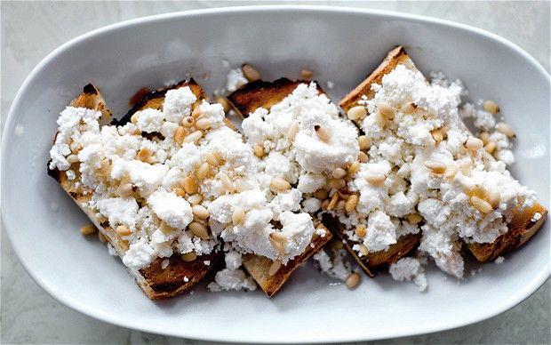 Crostini with Sardinian smoked ricotta, acacia honey and pine nuts