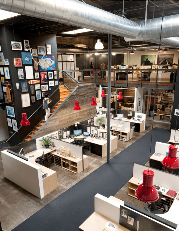 Love this office! Big workstations, red pendant lights, exposed industrial ceilings