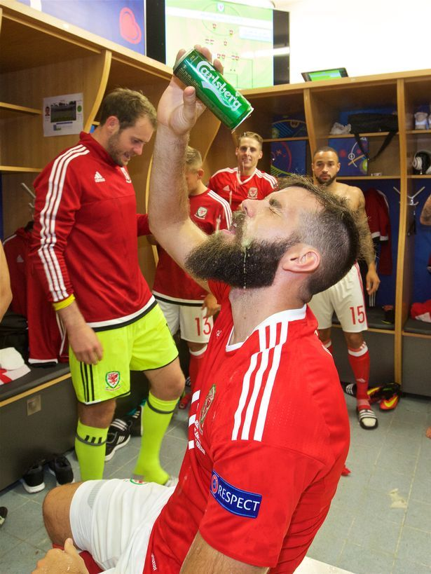 Joe Ledley enjoys a cold one in the changing room