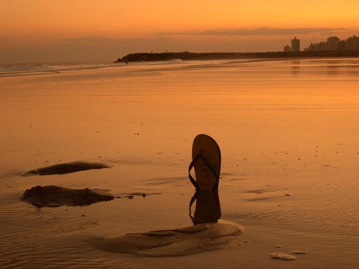beach life: sunset at miramar beach, argentina