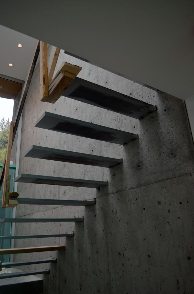 Best Steel Cantilevered Steps Attached To Concrete Wall Trap 400 x 300