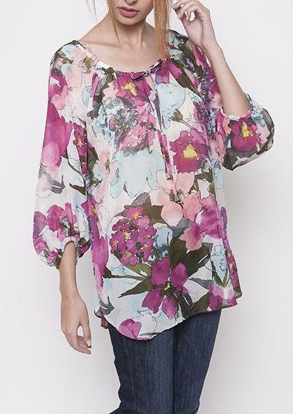 Comfortably dressed all day with patterned blouse with raglan sleeves and pleat neckline and sleeves