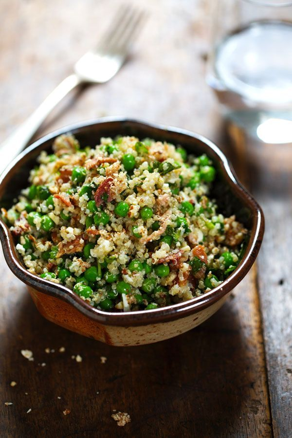 This Spring Quinoa Salad has quinoa tossed with peas, fresh herbs, feta, bacon, and almonds, plus a homemade Honey Lemon Vinaigrette.    pinchofyum.com