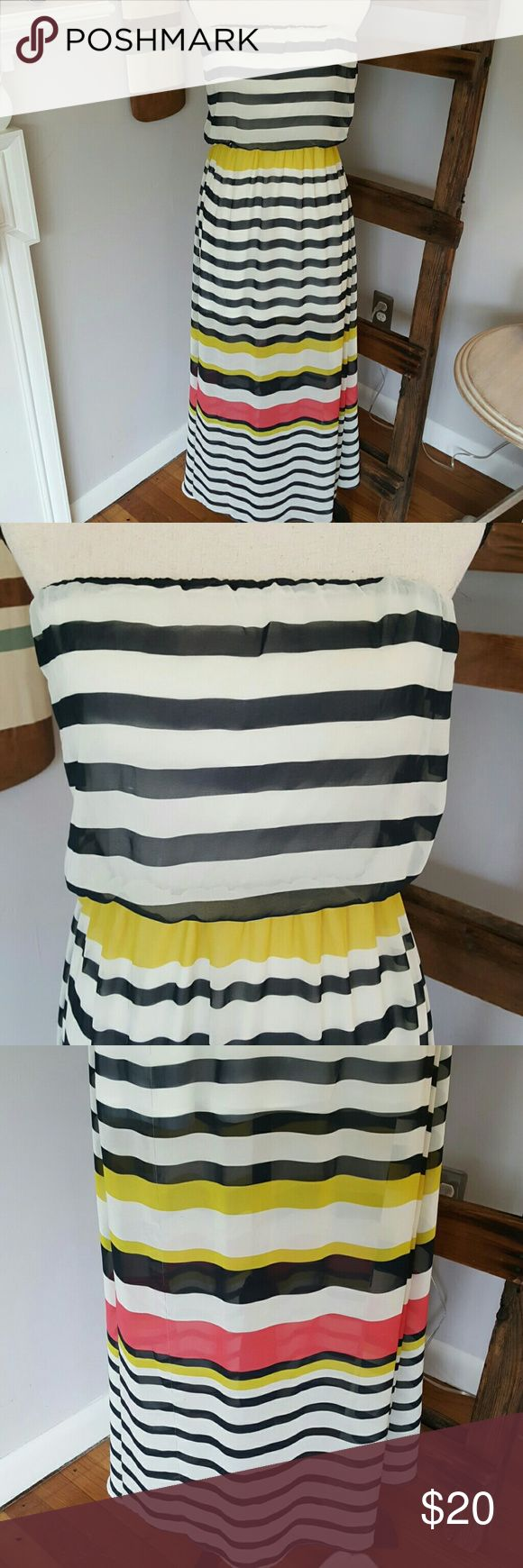 Perfect Summer Maxi dress Worn one time! It's just not for me but perfect for one of you ??  This dress is white with navy stripes, accented with yellow and coral stripes on the wait and bottom. It's made of a light chiffon-y material and is lined inside (the skirt lining goes down to just above the knee, as is the style).  The waist and top are elastic so it won't slip down out of place. This dress is perfect for BBQs, derby parties, or even a casual wedding.   Buy before 12pm EST and I'll…