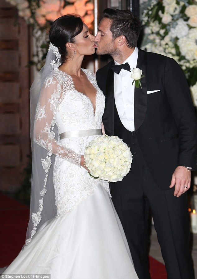 Man and wife:Christine Bleakley andFrank Lampard sealed their wedding ceremony with a kiss, after tying the knotat St Paul's Church in London