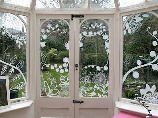 Pretty window drawings!  Easy to do with chalk markers