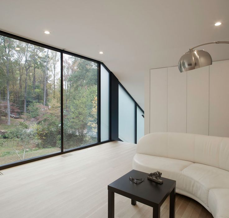 TABLE   Large Floor To Ceiling Windows Provide Plenty Of Natural Light To  The Space And Views Of The Surrounding Trees