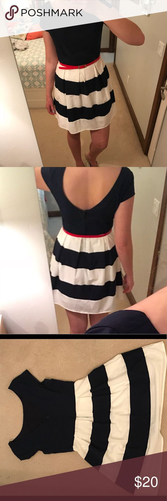 Navy blue white striped dress with belt Navy blue dress with white stripes. Flared skirt. Bright red belt included. Zip up back. Low-rise back. 94% polyester 4% spandex. Super comfortable. Looks great with gold jewelry B. Smart Dresses Mini