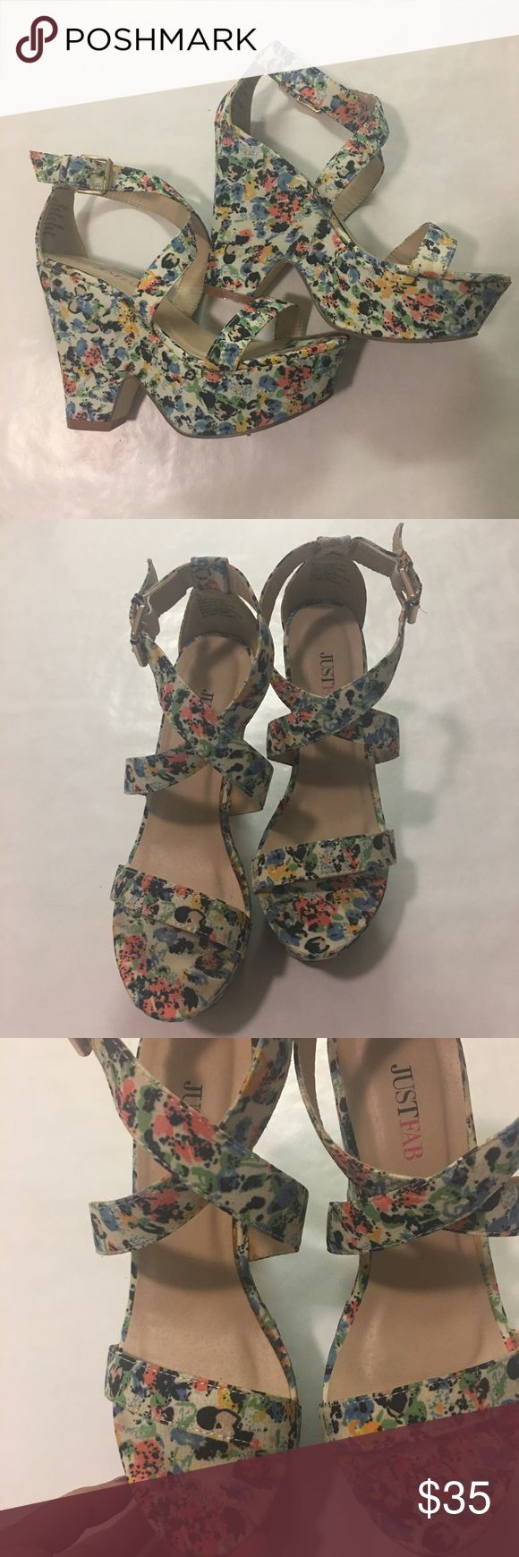 A pair of cute high heels from JustFab worn once These are comfortable colorful and floral heels from JustFab. I only wore them once so they're still in good condition. About a 3-4 inch heel JustFab Shoes Heels