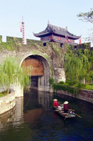"""Suzhou's city wall is unique among all city walls in China.   It has two layers of """"walls"""": one structured with bricks and another formed by a water channel that encircles the brick wall and connects to the waterways north to Beijing and south to Hangzhou."""