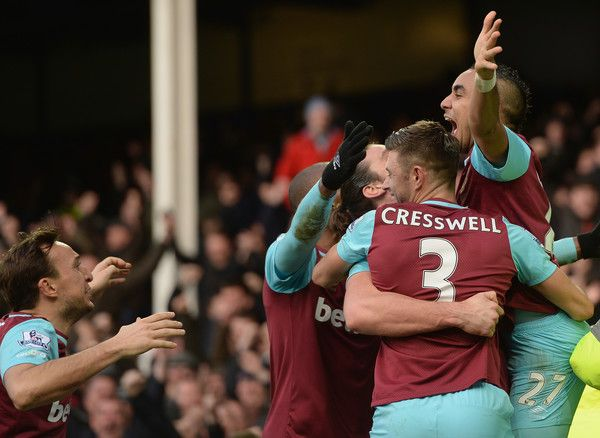 Dimitri Payet (1st R) of West Ham United celebrates scoring his team's third goal with his team mates during the Barclays Premier League match between Everton and West Ham United at Goodison Park on March 5, 2016 in Liverpool, England.