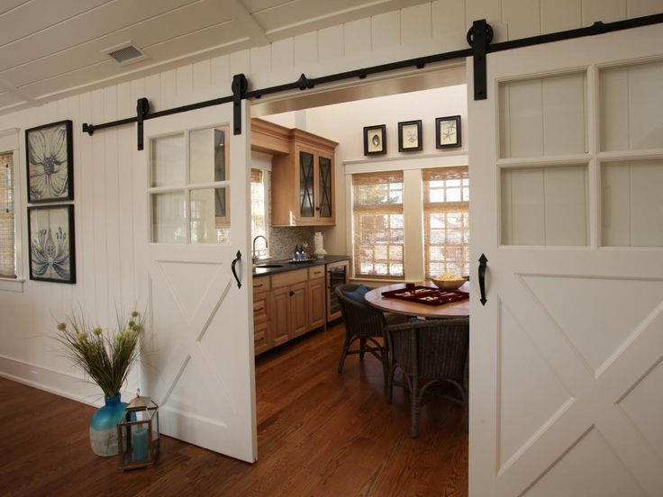 Sliding barn doors offer both easy access to and privacy for this large family game room. The doors can be closed to create a private retreat or opened up to facilitate easy entertaining of family and friends.
