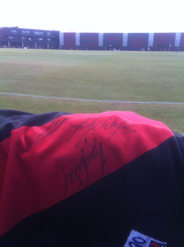 Bombers high performance training facility and oval, with bombers singlet signed by Stanton, Watson and heppell