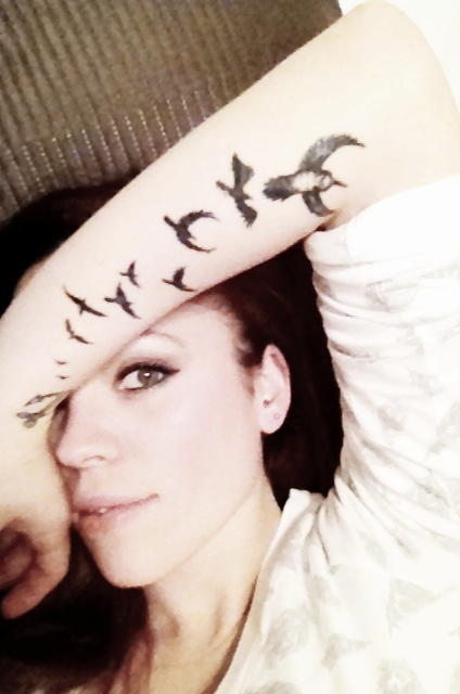 Forearm tattoo...i'd love this with the quote she flies with her own wings