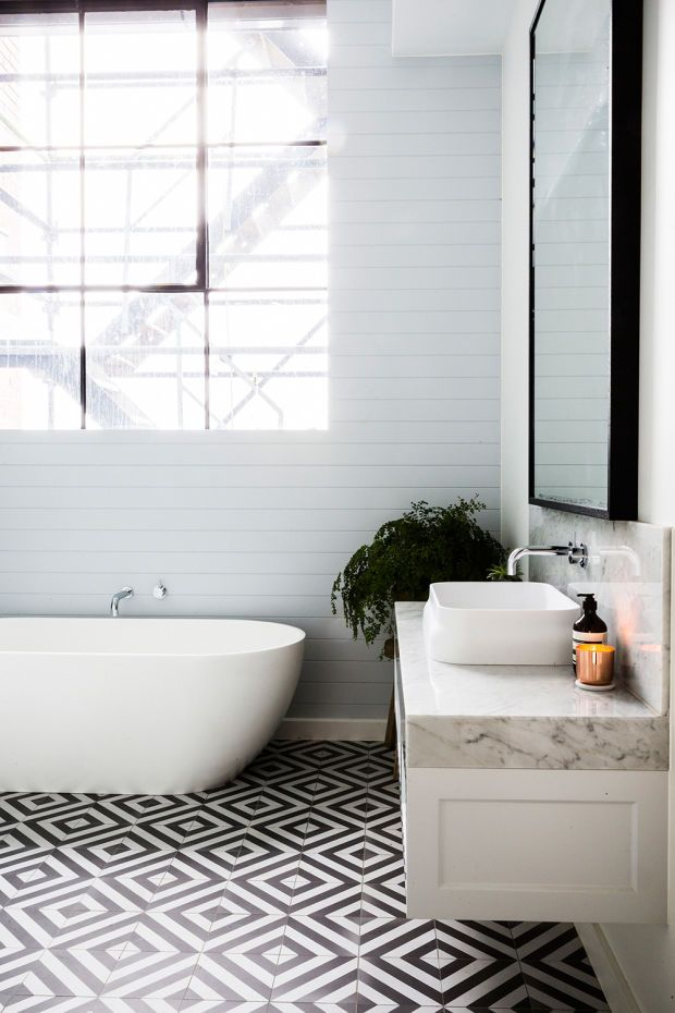 Love how the feature tiles in this bathroom are on the floor instead of the wall!