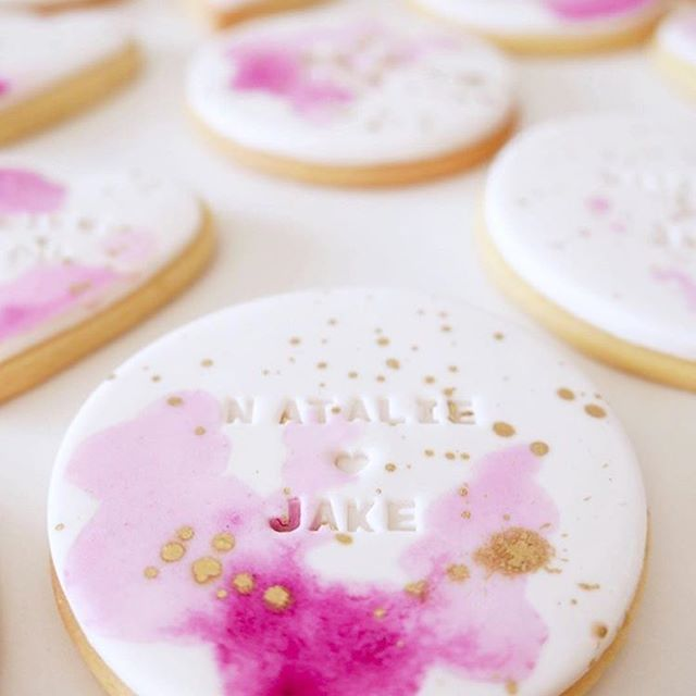 Watercolor cookies with a stamped name. #wedding favor