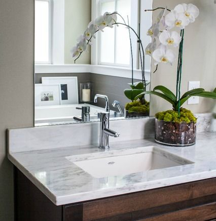 By Undermounting The Bathroom Sink There Is Ample Countertop Space Left For Toiletries And Accessories